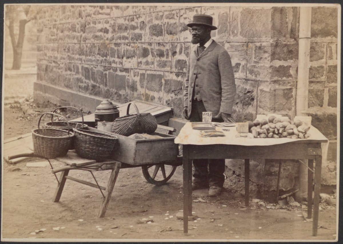 James C. Johnson with goods for sale