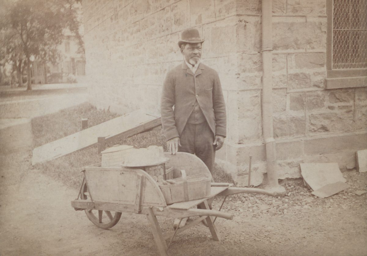 James C. Johnson with wheelbarrow